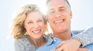 Picture of middle aged couple outside smiling